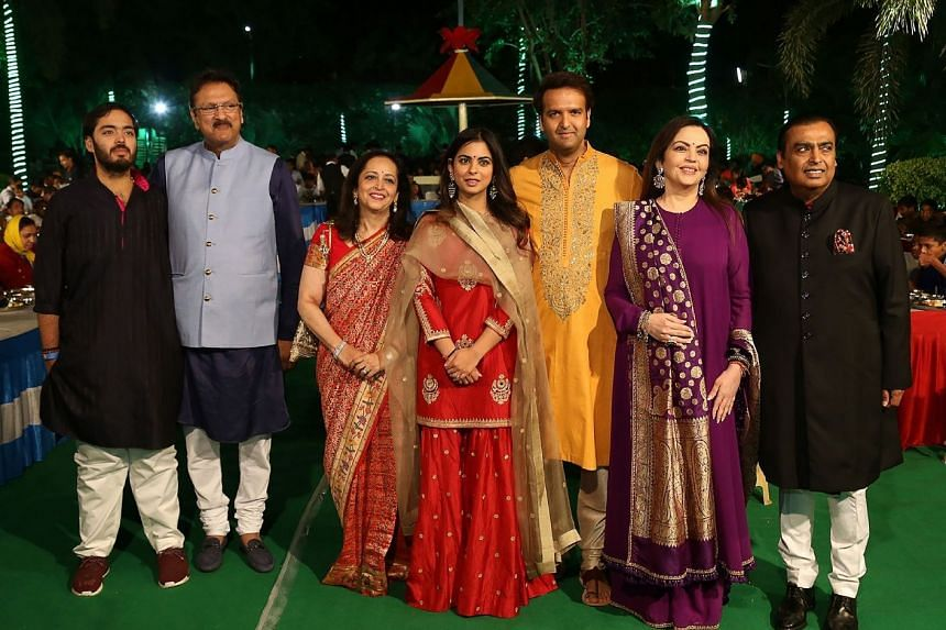 The wedding of Ms Isha Ambani (centre) and Mr Anand Piramal (third from right) brings together two of India's biggest industrialist families.