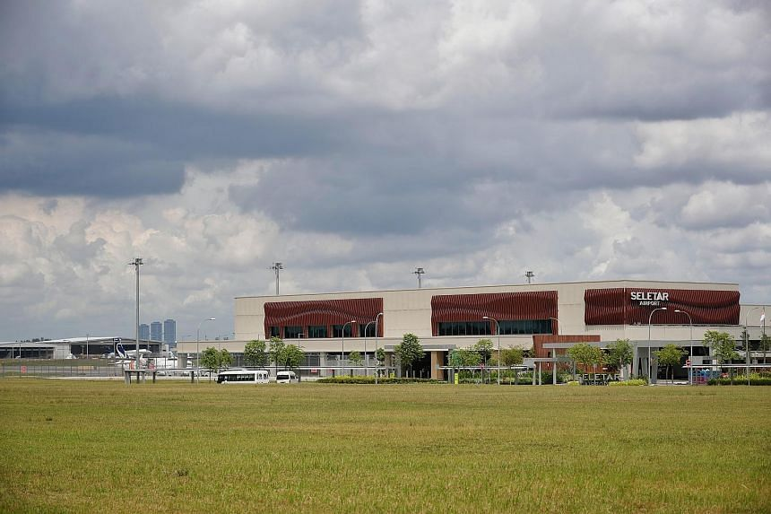 Singapore Transport Minister Khaw Boon Wan said that plans to introduce an Instrument Landing System at Seletar Airport (pictured) will not pose any safety or security risks to Johor's Pasir Gudang port.