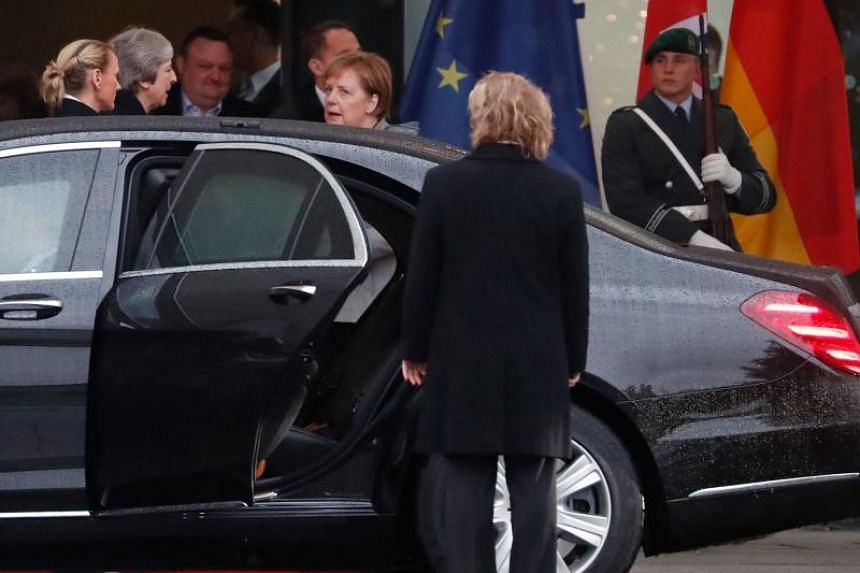 German Chancellor Angela Merkel bids farewell to British Prime Minister Theresa May before she leaves in her car at the Chancellery in Berlin, on Dec 11, 2018, after bilateral talks.