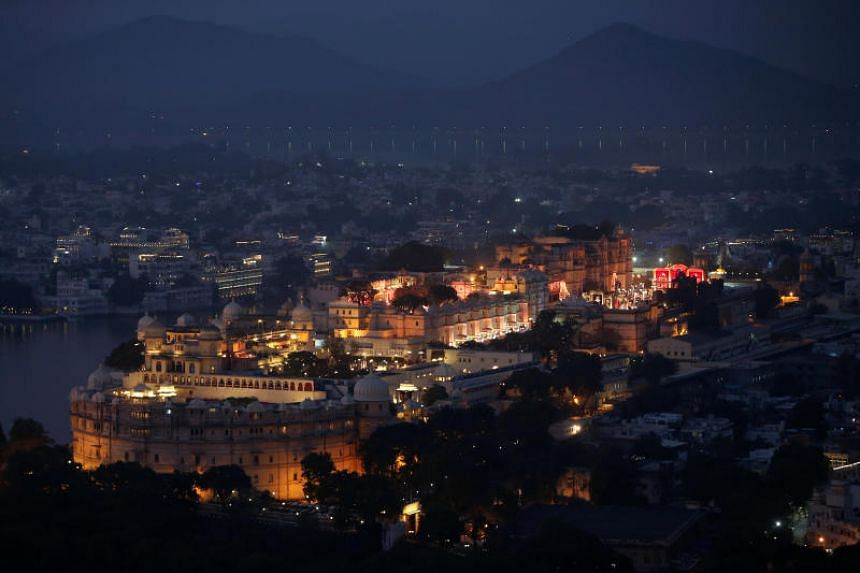 A view of the illuminated City Palace, one of the venues for the Ambani-Piramal pre-wedding celebrations.