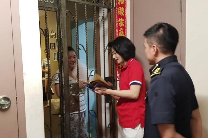 MP for Pasir Ris-Punggol Sun Xueling went door-to-door to engage residents in her ward on fire safety and prevention as part of public education efforts on Dec 12.