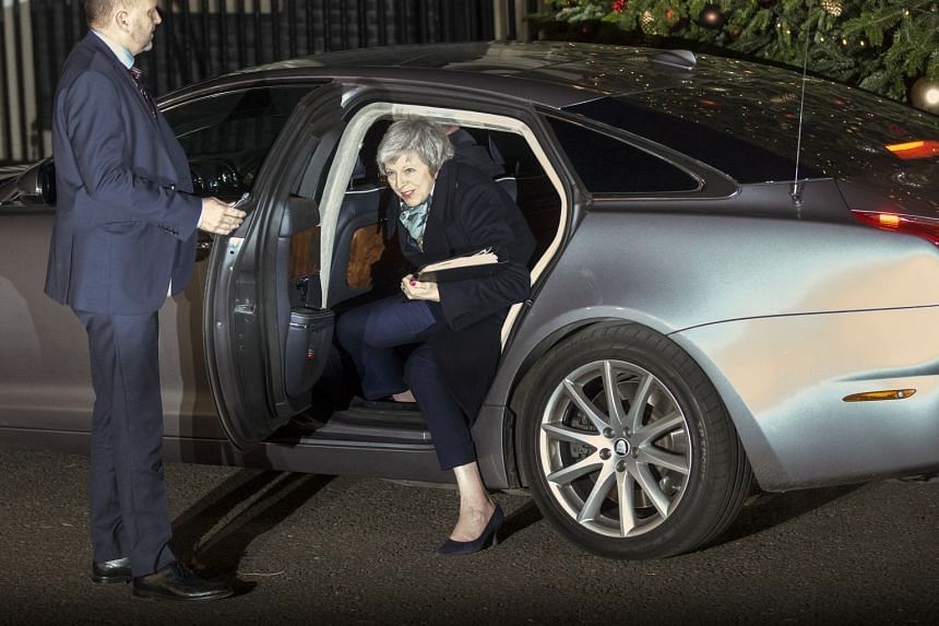 Mrs May returns to No. 10 Downing Street in London on Dec 12, 2018.