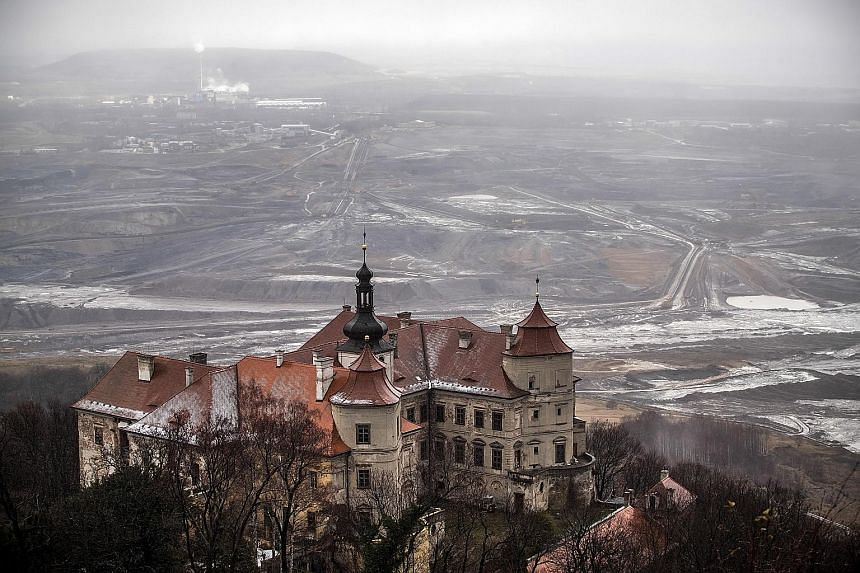 An open brown coal mine behind Jezeri Castle in the Czech Republic on Tuesday. In neighbouring Poland, where the UN climate change talks are being held, Singapore Minister for the Environment and Water Resources Masagos Zulkifli acknowledged that put
