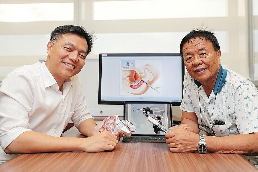 Dr Lincoln Tan (left), NUH's director of urologic oncology, with Mr Tan Ai Poh, a patient who had the transperineal prostate biopsy carried out last month with local anaesthesia and has been given the all-clear.