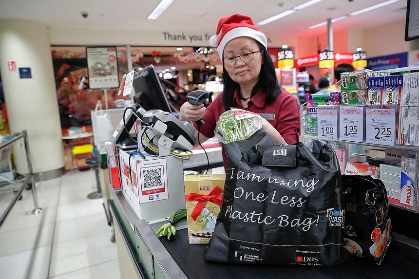 Under the One Less Plastic campaign, shoppers who spend more than $50 at participating supermarkets can redeem a reusable bag for groceries.