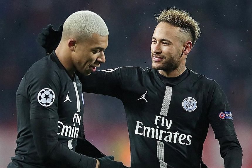 Paris Saint-Germain scorers Kylian Mbappe (left) and Neymar celebrate after their 4-1 Champions League win over Red Star Belgrade.
