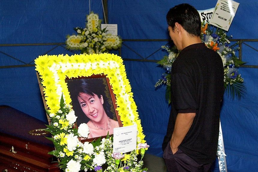 Left: The then 15-year-old, who killed Ms Annie Leong at the behest of her estranged husband Anthony Ler (above), leaving the High Court in November 2001. Below: Ler at Ms Leong's wake. He was hanged in December 2002 for abetment of murder.