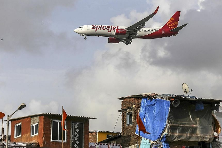 A SpiceJet plane landing at Chhatrapati Shivaji International Airport in Mumbai. Indian airlines have faced mounting losses due to high jet-fuel prices and a weak rupee that outweighed an increase in passenger traffic.