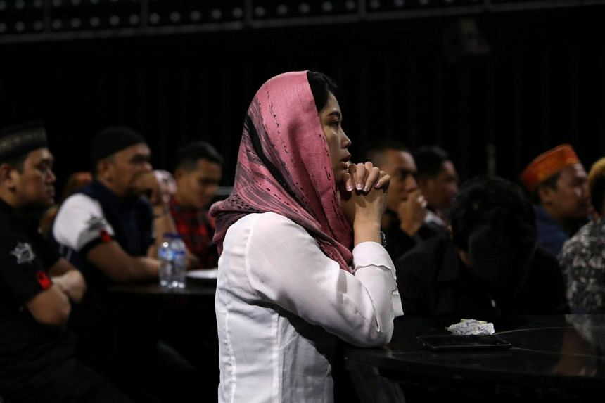 Staff at Boshe VVIP Club listen to a sermon by Mifta'im An'am Maulana Habiburrohman, who aims to create a safe space to worship for those who work in the entertainment industry, in Kuta, Bali, on Nov 27, 2018.