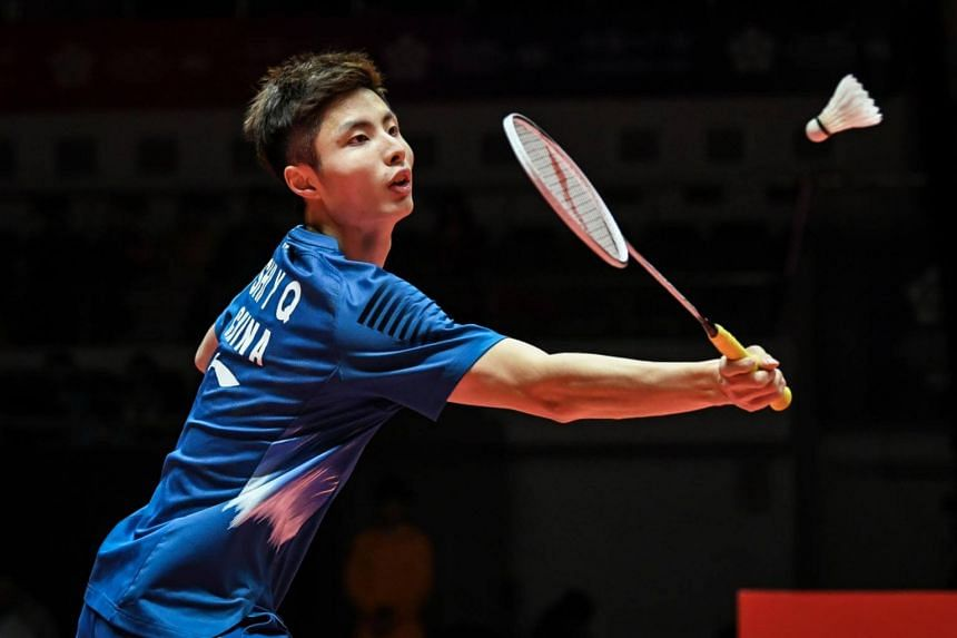 Shi Yuqi hits a return during his men's singles first round match at the 2018 BWF World Tour Finals of badminton in Guangzhou, on Dec 12, 2018.