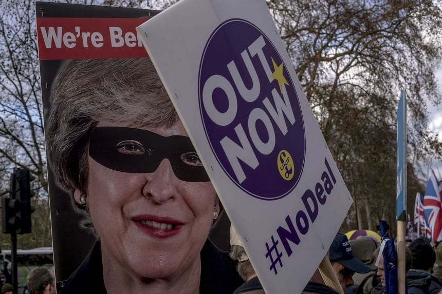 A poster mocking Prime Minister Theresa May at a rally of hardline Brexit supporters in London, Dec 9, 2018.