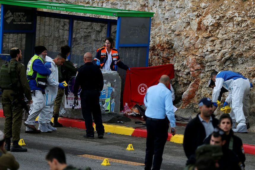 Israeli forces and medics at the scene of a shooting attack near Ramallah in the Israeli-occupied West Bank on Dec 13, 2018.