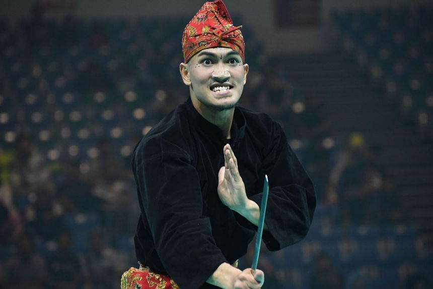 Muhammad Iqbal Abdul Rahman in the men's artistic single at the World Pencak Silat Championship on Dec 13, 2018. The 25-year-old Singaporean won to clinch his first world title in five attempts.