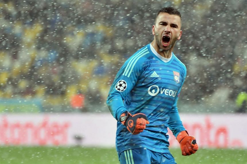 Lyon's Portuguese goalkeeper Anthony Lopes reacts after the match.