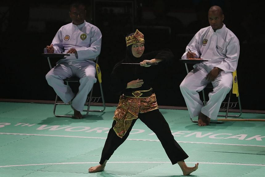 Singapore's Nurzuhairah Mohd Yazid in the women's artistic single final of the 18th World Pencak Silat Championship at OCBC Arena on Dec 13, 2018. She took the gold.