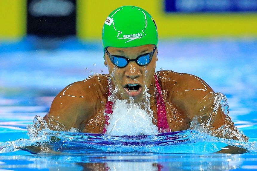 Alia Atkinson of Jamaica on her way to the 50m breaststroke gold in Hangzhou last night. It was her first 50m title at the short course World Swimming Championships after three silvers.