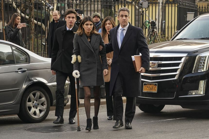 Michael Cohen (right) walking with family members to federal court in Manhattan, Dec 12, 2018.