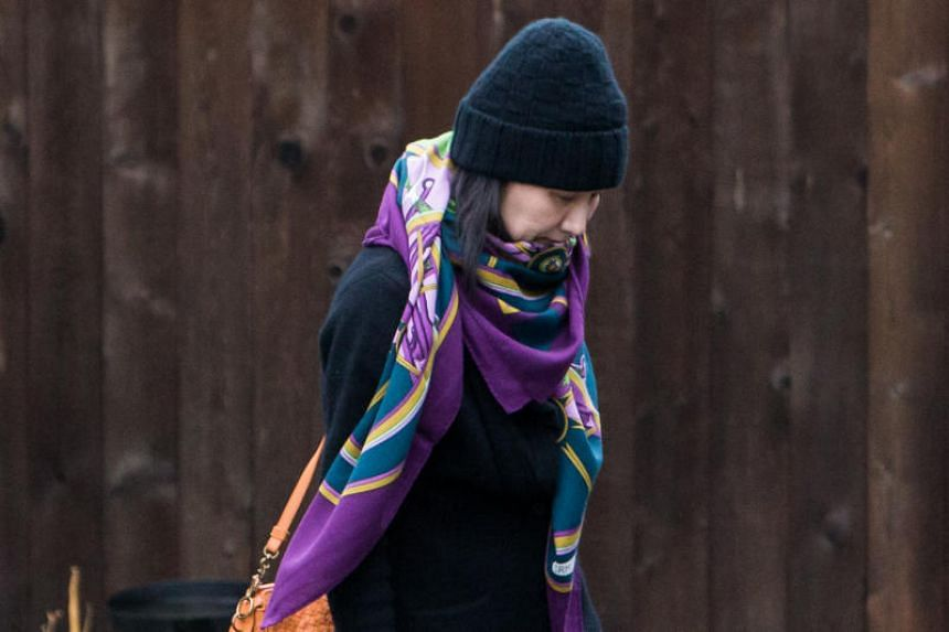 Meng Wanzhou leaves her home under the supervision of security in Vancouver, Canada, on Dec 12, 2018.
