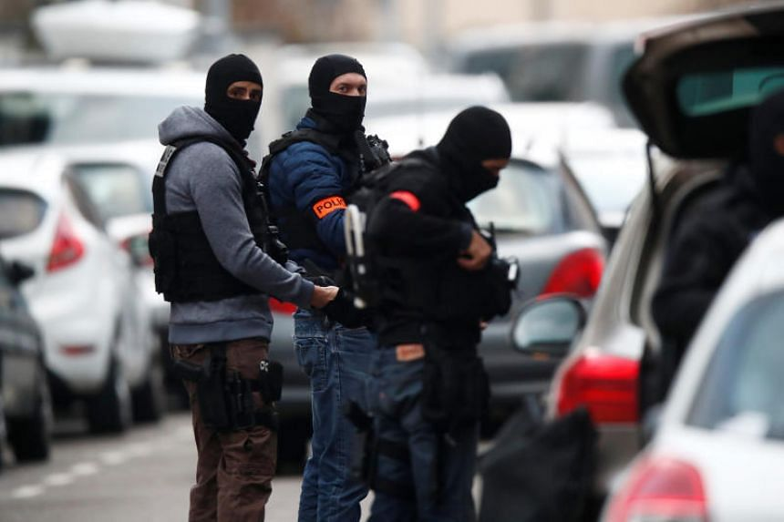French special police forces secure a street during a police operation in the Neudorf district after s deadly shooting in Strasbourg, France, on Dec 13, 2018.