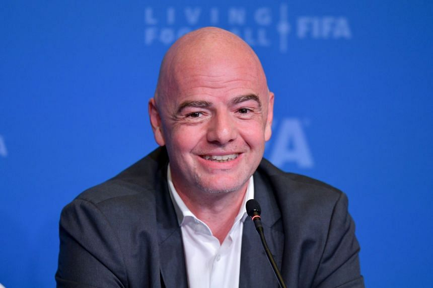 Infantino speaking to journalists at the end of the Fifa executive football summit in Doha, Qatar.