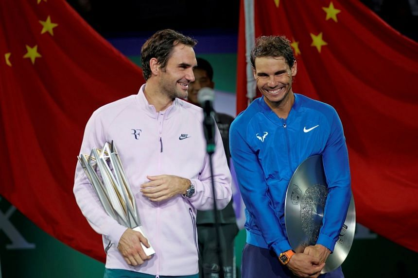 Federer (left) and Nadal after the final of the 2017 Shanghai Masters tennis tournament in China.