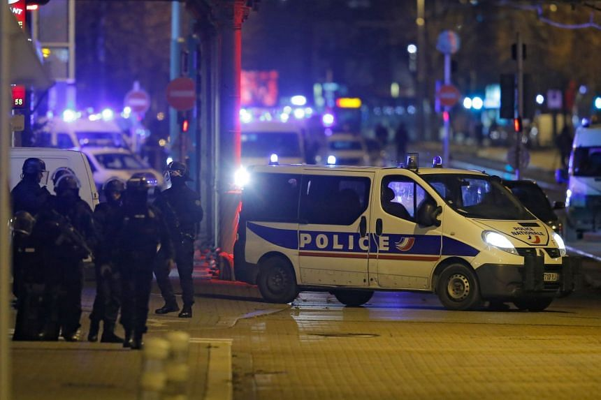 French special police forces secure an area during a police operation in the Meinau district of Strasbourg.