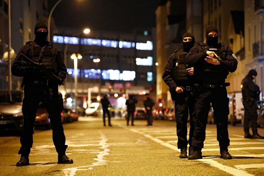 French special police forces secure an area during a police operation where suspected gunman Cherif Chekatt was killed.