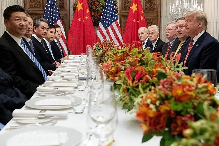 Chinese President Xi Jinping, United States President Donald Trump and their respective delegations during dinner at the end of the Group of 20 summit in Buenos Aires, Argentina, on Dec 1.