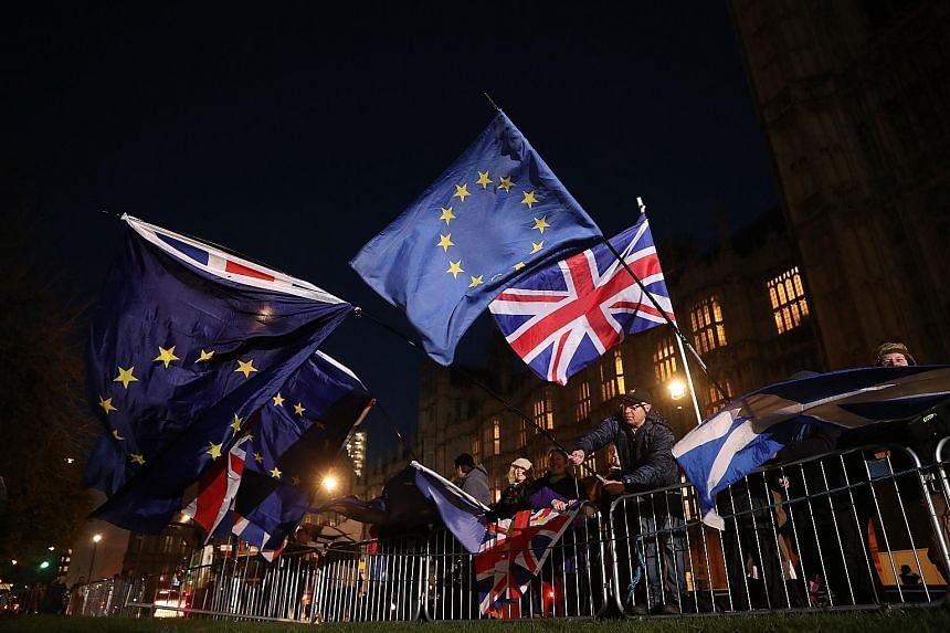 Anti-Brexit campaigners waving the Union Jack and European Union flags outside the Houses of Parliament in central London on Wednesday. Pro-Europeans fear that the exit from the bloc will weaken the British economy and its international standing.