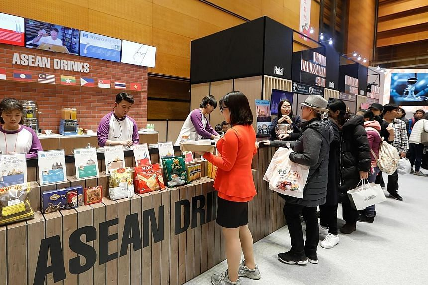 Visitors lining up to sample beverages at the third Asean Culinary Festival, organised by the Asean-Korea Centre and held from Nov 28 to Dec 1 in Seoul. Next year will see more opportunities for cooperation, with Asean and South Korea marking 30 year
