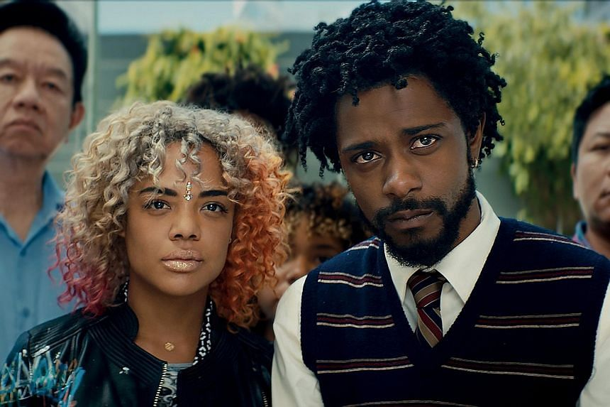 Cassius (Lakeith Stanfield, above) takes a soul-crushing telemarketing job and rises up the corporate ladder because on the phone, no one can tell he is black.