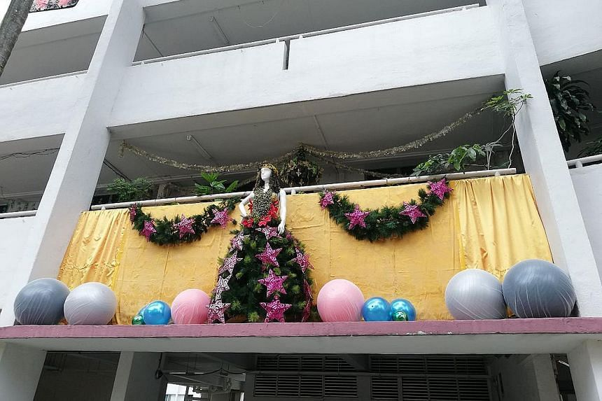 Christmas decorations with a mannequin as the centrepiece (above) on the second-storey ledge outside a flat at Block 351 Clementi Avenue 2. The mannequin appears to be fixed to the railing (below) using twine. Jurong-Clementi Town Council said the pi