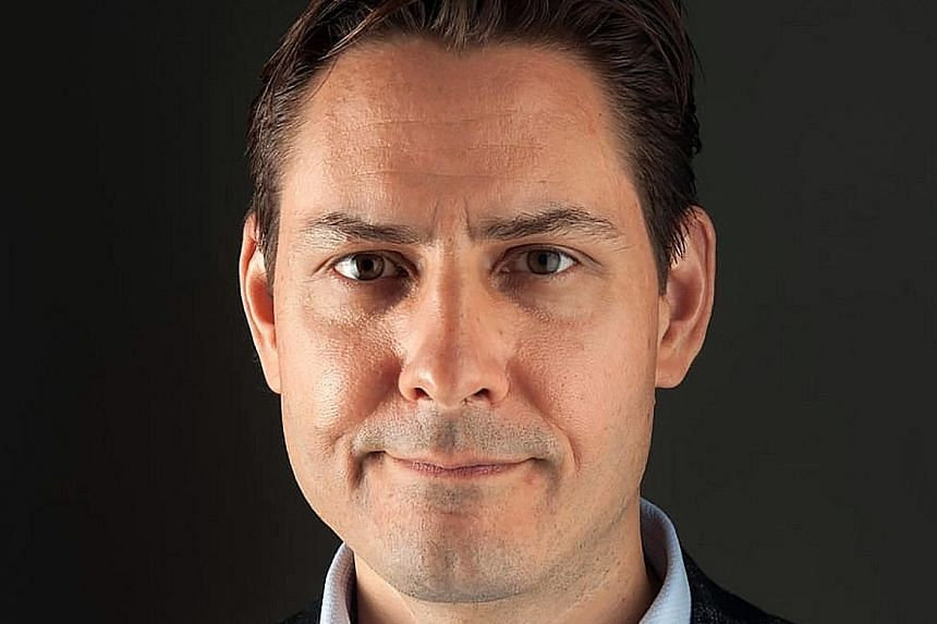 Former Canadian diplomat Michael Kovrig (top) was detained in Beijing on Dec 1, the same day that businessman Michael Spavor was held by officials from the national spy agency in Dandong.