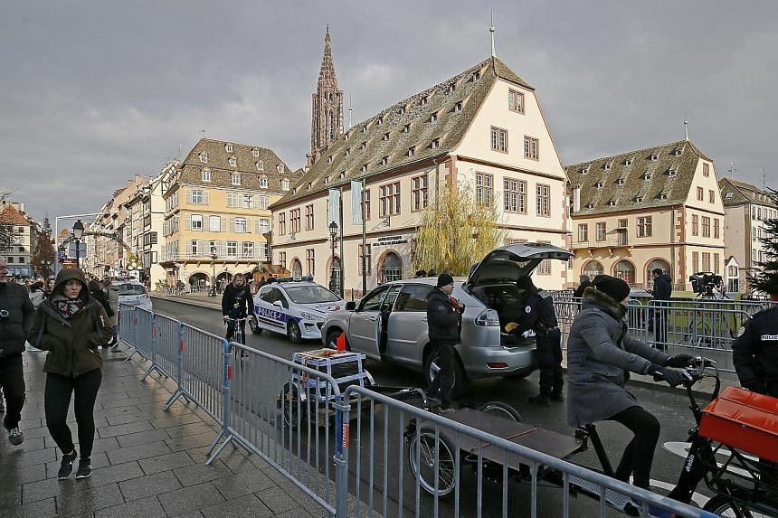 Security personnel checking vehicles in Strasbourg yesterday as police across France hunt for the main suspect in an attack on a Christmas market in the eastern city on Tuesday.