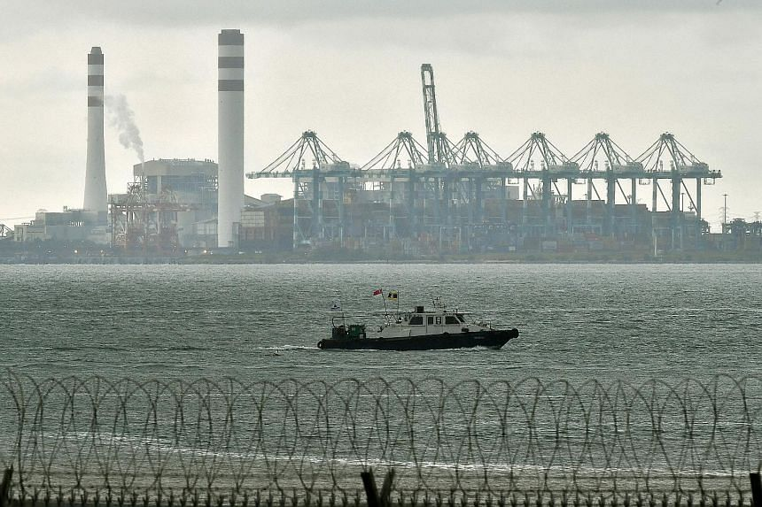 Tanjung Bin Power Plant and part of the Port of Tanjung Pelepas, a container terminal in Johor Baru, as viewed from Tuas West Drive. The United Nations Convention on the Law of the Sea governs all aspects of how the world's seas and oceans, and their