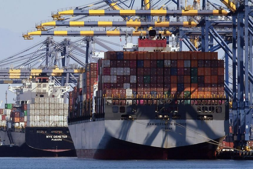A ship which has just arrived from Shanghai in China unloads Chinese shipping containers at the Port of Long Beach, in Los Angeles County on Sept 29, 2018.