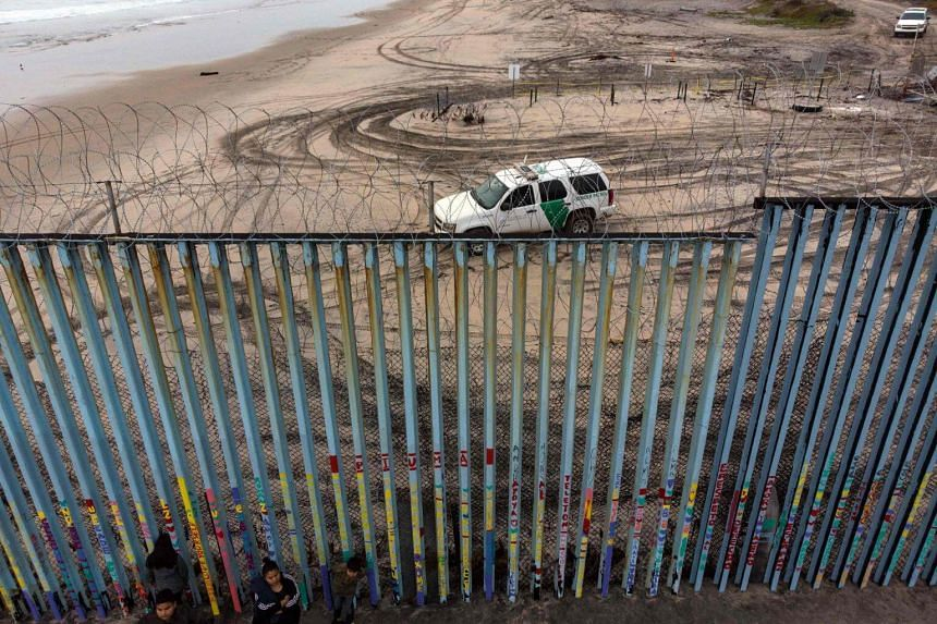 Aerial view of the border patrol guarding the US-Mexico border fence in Playas de Tijuana, Mexico, on Dec 9, 2018.