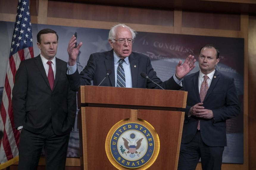 Senator Bernie Sanders (centre) speaks about the bill to end the US support for the war in Yemen on Dec 13, 2018 in Washington, DC.