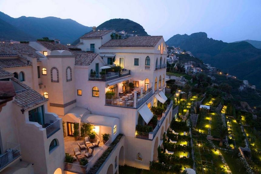 Belmond owns or has stakes in more than 30 high-end hotels around the world, including Hotel Caruso on the Amalfi Coast in Italy (above).