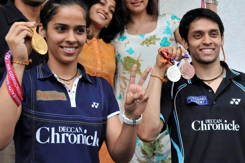 A file photo taken on Oct 16, 2010, shows Indian badminton players Saina Nehwal and Parupalli Kashyap with their New Delhi Commonwealth Games medals. Nehwal announced her marriage to Kashyap on Dec 14, 2018.