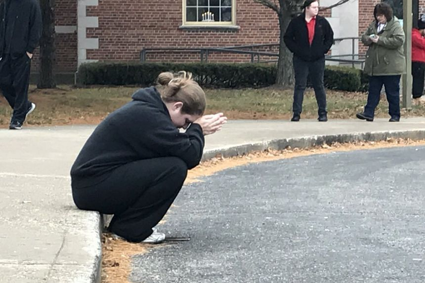 A photo said to be of a parent waiting for her children posted to Twitter after the incident.