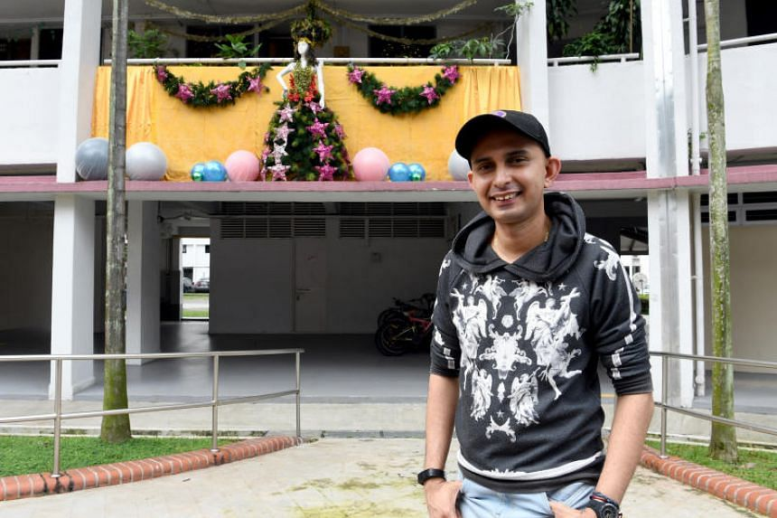 Mr Philip Sobrielo Gene, 38, with his Christmas decorations outside his mother's house in Clementi. ST PHOTO: KHALID BABA