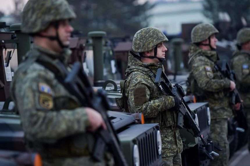 Members of the Kosovo Security Force stand at attention during the visit of Kosovo President at a barracks in Pristina, Kosovo, on Dec 13, 2018.