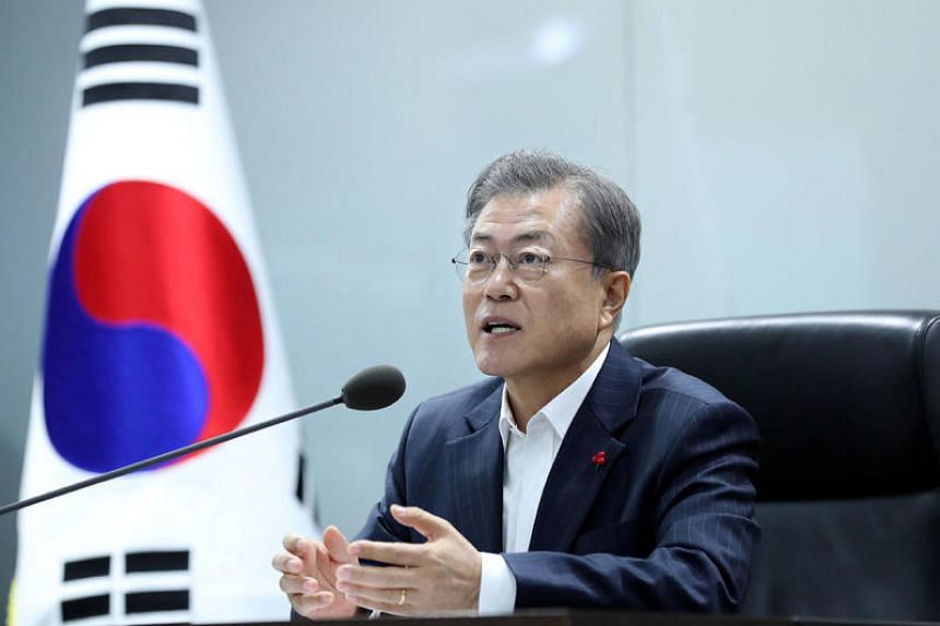 South Korea's President Moon Jae-in said the government would take its time to seek a solution because the issue was triggered by a judicial ruling and must be respected by the government.