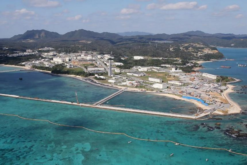 Land reclamation work being conducted to build a new site for relocating a US military airbase on the Henoko coastal district of Nago, Okinawa, on Dec 14, 2018.