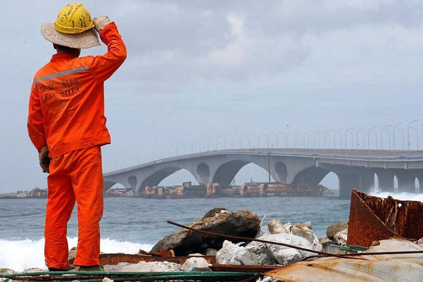 A construction worker looks at the China-funded Sinamale bridge, in Male, Maldives, on Sept 18, 2018.