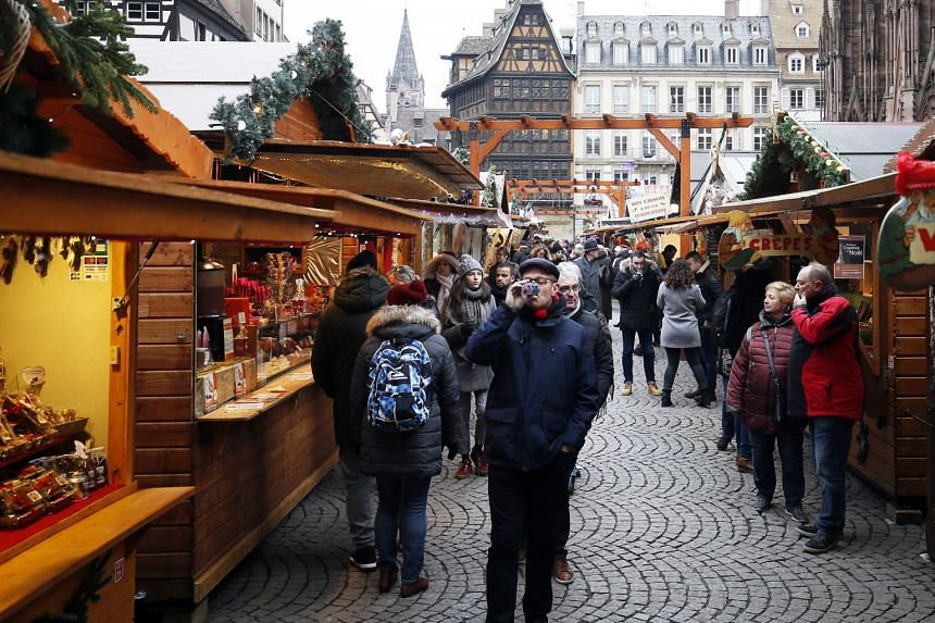 People visiting the Christmas market, in Strasbourg, on Dec 14, 2018.