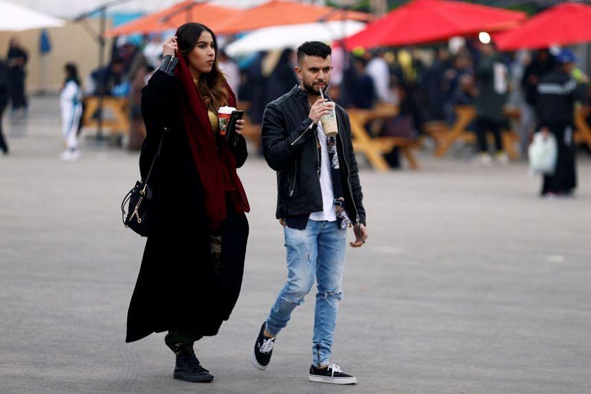 Tourists are seen attending a Formula E race in Saudi Arabia, Dec 15, 2018.