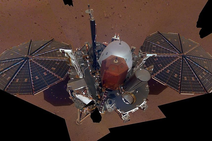 A photo from Nasa showing the first full selfie taken by its spacecraft InSight on Mars. It displays the lander's solar panels and deck. On top of the deck are its science instruments, weather sensor booms and antenna.