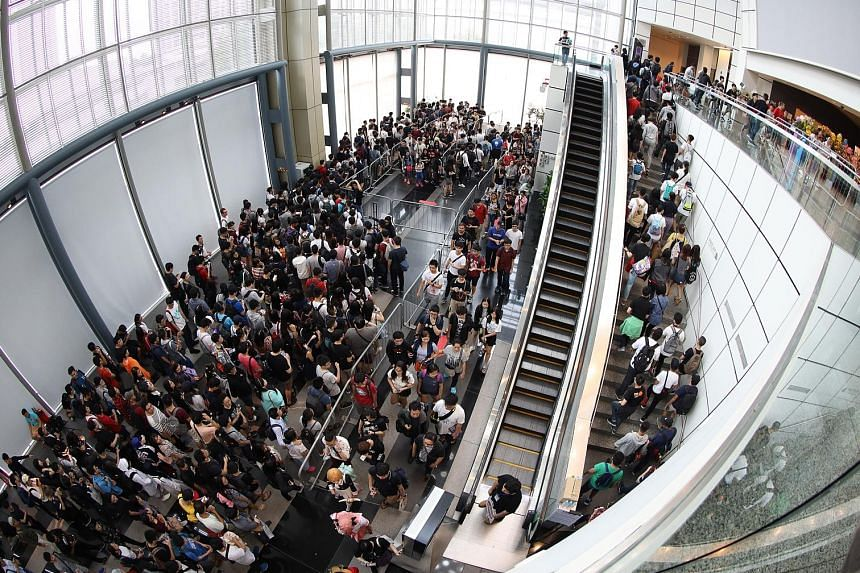 The crowd waiting to enter the Anime Festival Asia at the Suntec Singapore Convention and Exhibition Centre on Dec 1.